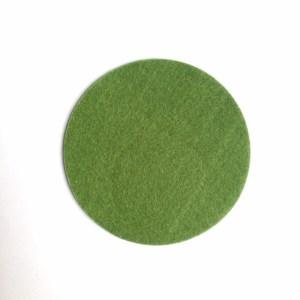 ronde onderzetter handgemaakt van hittebestendig en zacht groen vilt