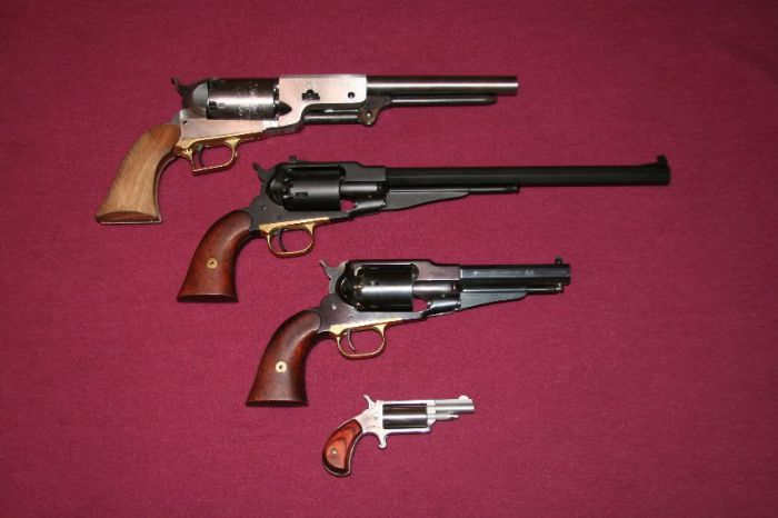 Walker Kit Gun (top) with matt nitride-finished Buffalo, Remington 1858 Sheriff's model, and North American Arms' .22 percussion pistol.