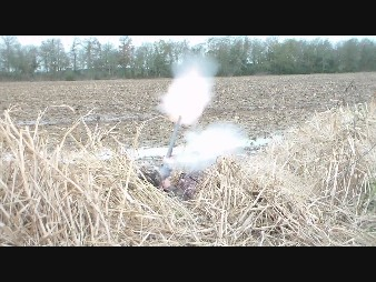 Side blast from flintlock guns can ignite dried grasses covering the duck blind.