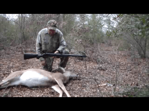 The Author with a Knight Rolling Block muzzleloading rifle and a Georgia doe.