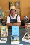 Author in costume for book signing.