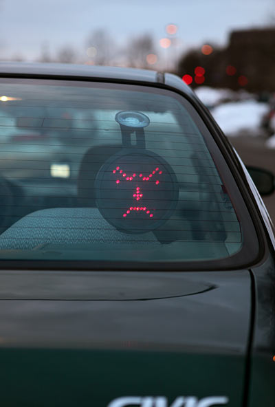 This goes on your back windshield & you have a control upfront that lets you