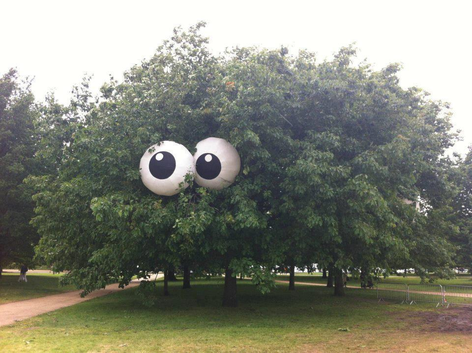 Beach balls painted to look like eyes put in a tree. Glow in the dark paint for
