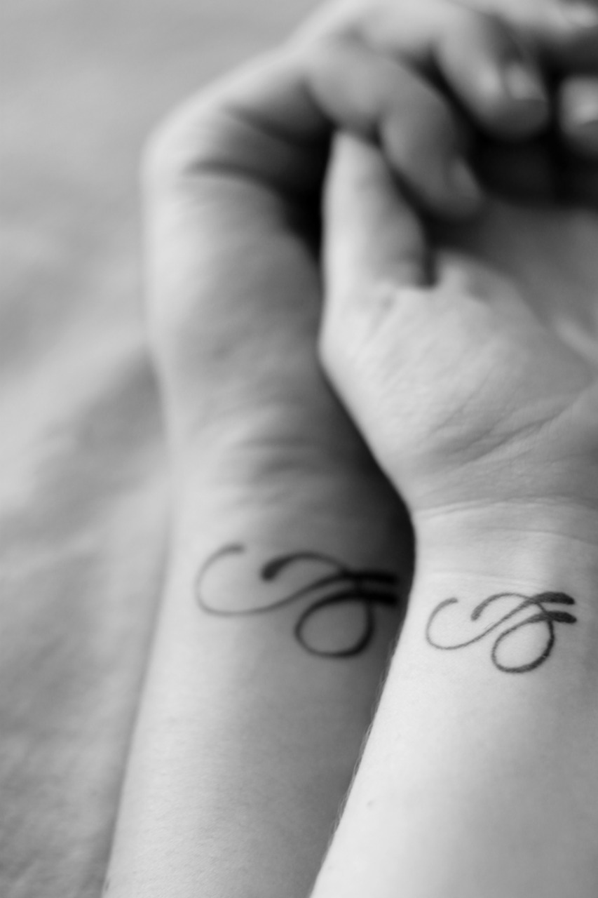 our couples tattoo the design is the first letters of our names intertwined e we know how to. Black Bedroom Furniture Sets. Home Design Ideas