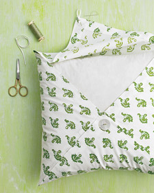 easy fabric into pillows – tack 3 corners together with the button and 1 corner