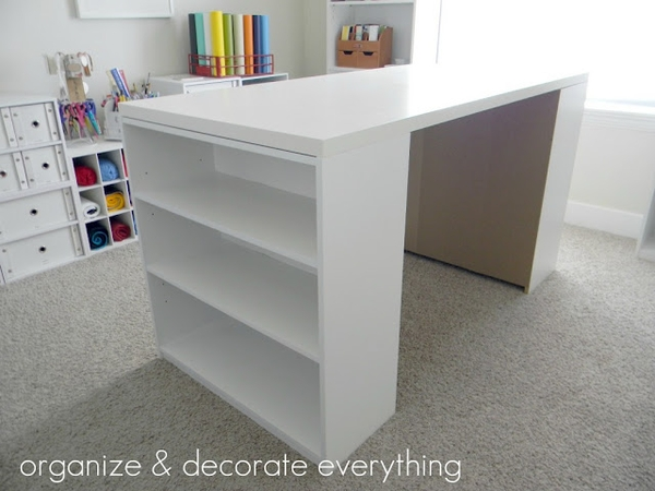 DIY Craft Table; two $15 Walmart bookshelves and sheet of cabinet grade plywood.
