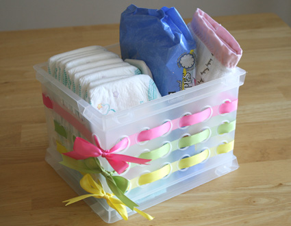 Embellish those cheap dollar store bins with ribbon — cute!