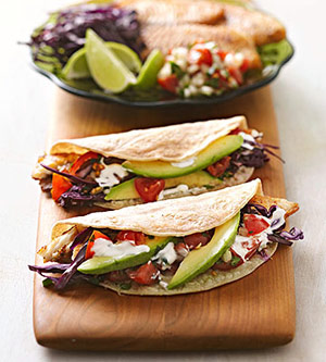 Tilapia Tacos – Mild flaky fish, colorful slaw, avocado and a creamy greek yogur