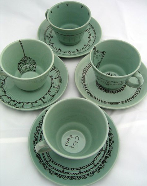thrift store cups with ceramic ink line drawings