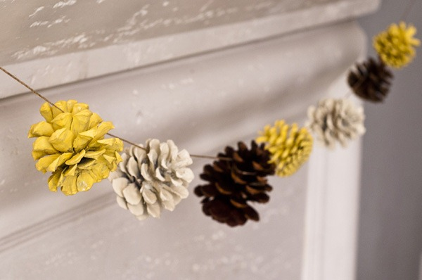 Spray paint pine cones different colors to create a colorful pinecone garland.