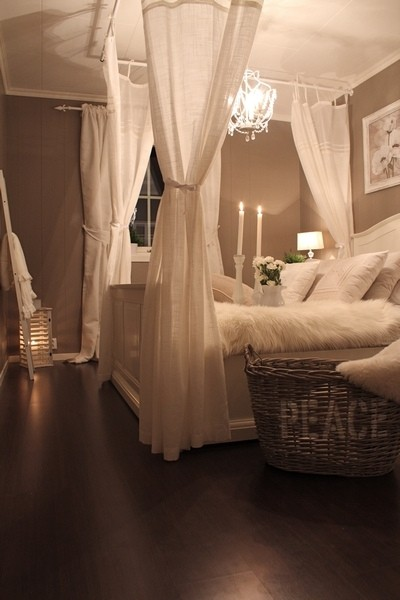 LOVE the faux canopy bed using curtain rods on the ceiling! Perfect.
