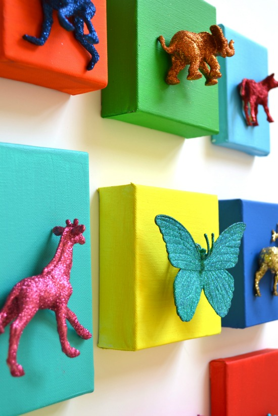 DIY:: Glittered animal canvases…Could be fun to pre-paint the canvases…then