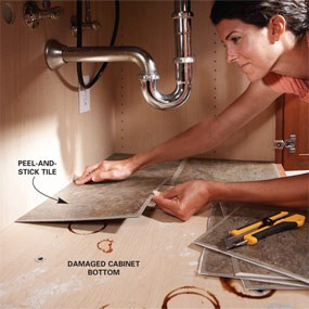 Peel and stick tiles under the sink. Looks clean and is easy to wipe the surface