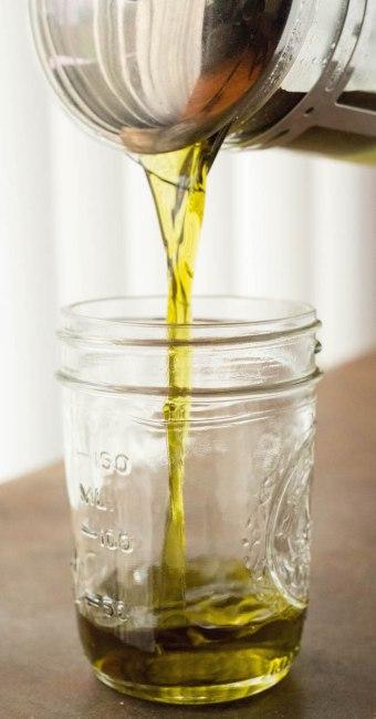 Pouring freshly made marijuana rosin chip coconut oil.