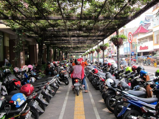 Parking is orderly in Jogja, where attendants arrange the motorbikes.