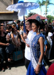 A local beauty queen joins the parade