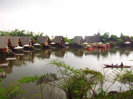 Bamboo gazebos and canoe at Saung Purbasari