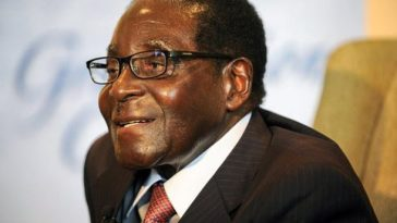 robert mugabe smiling