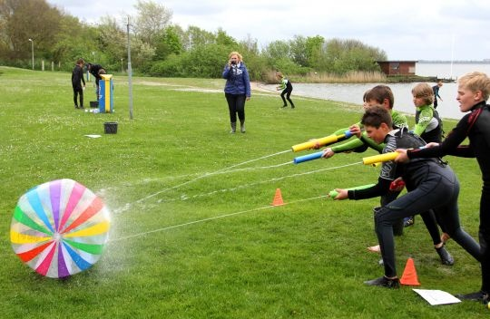 Water Games You and Your Family Will Love to Play This Summer beach ball blaster water game