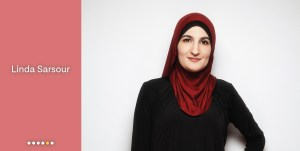 Meet Linda Sarsour, portrait of Sarsour smiling at the camera, wearing a red hijab.