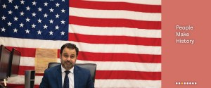 People Make History: Meet the Narrators, a picture of Mohammad Razvi at his desk in front of an American flag.