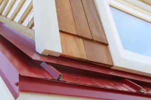 Putting up the cedar shakes that will line the dormers.