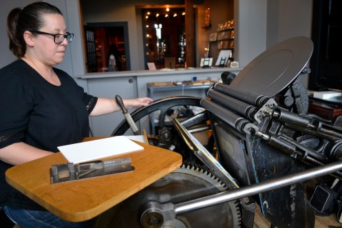 Kerri Velazquez works the Chandler & Price Letterpress.