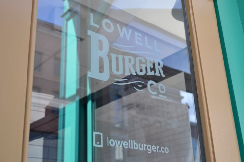 Lowell Burger Company's logo one their doors.