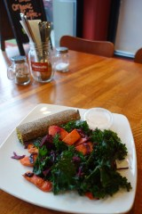 Tasty spinach and cheese flaxseed roll with kale, carrot and beet salad in Vancouver