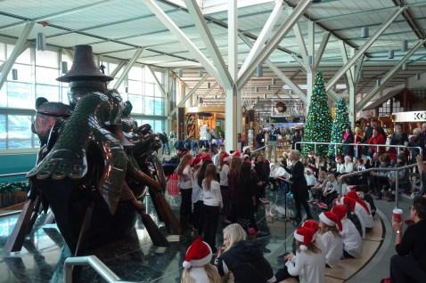 A school choir singing us Christmas songs in Vancouver airport
