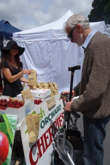 Buying local cherries at the market