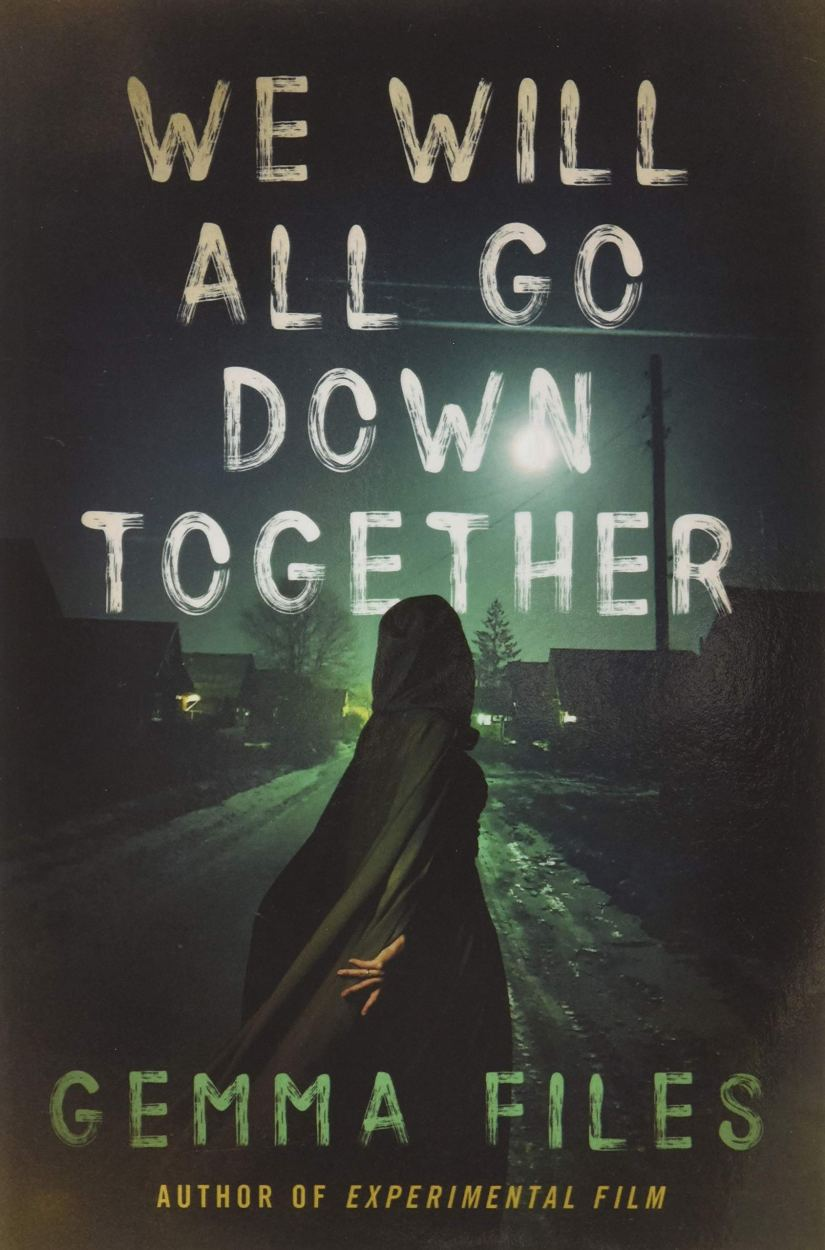 Cover of We Will All Go Down Together by Gemma Files. Cover shows a woman in a cloak walking down a street of small houses at night.