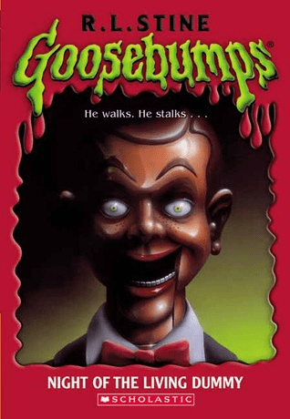 Cover of Night of the Living Dummy by R.L. Stine. Cover shows a ventriloquist's dummy with an evil smile and evil looking nearly all-white eyes.