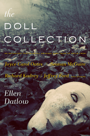 Cover of The Doll Collection, edited by Ellen Datlow. Cover shows a disembodied doll head on the ground outdoors among leaves. The doll head is old and dirty.