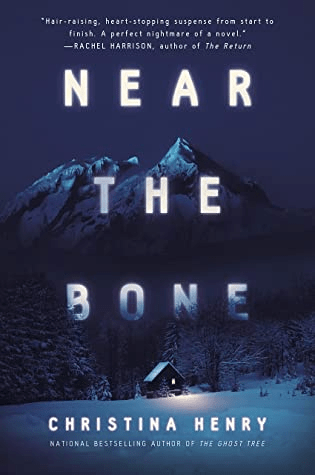 Cover of Near the Bone by Christina Henry. Cover shows a cabin in a snowy winter landscape. IN the background are trees and a mountain. The cabin is clearly secluded and appears to be in the mountain foothils.