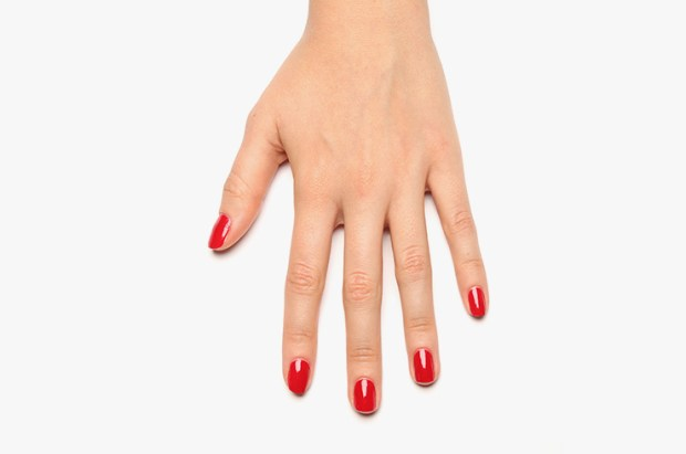 Red nail polish in two layers