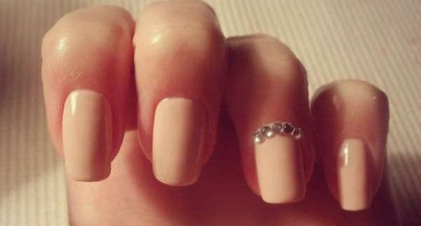 beige nail polish and stones designs