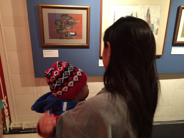 Woman and child looking at art