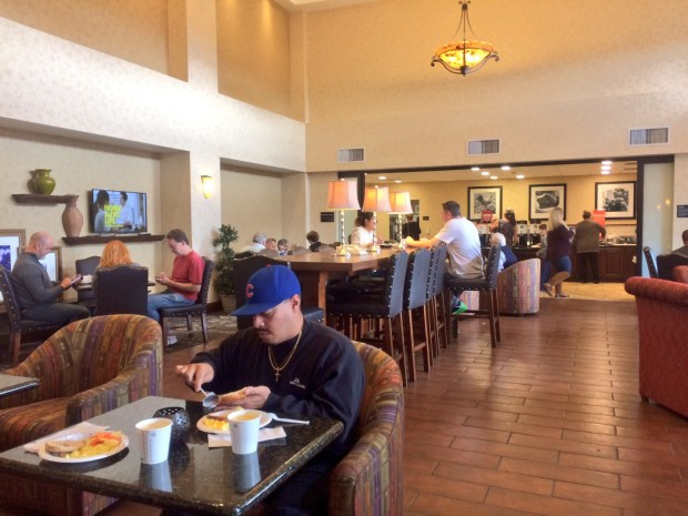Man eating breakfast in a hotel lobby