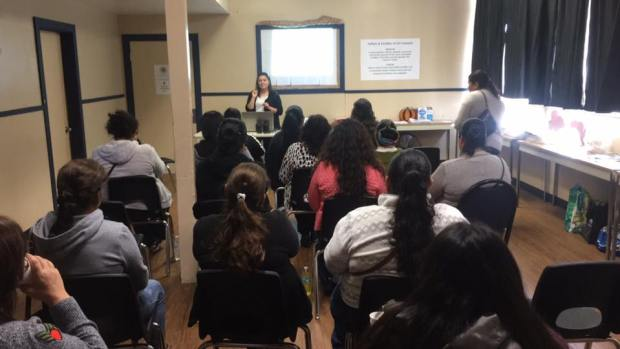Educational advocate, Dr. Nancy Haunte presents in front of a group of parents