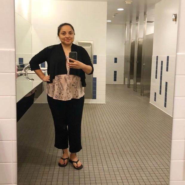 woman taking a bathroom selfie