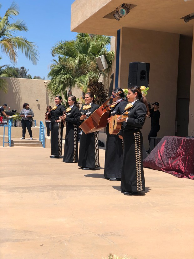 Female mariachi band plays on an outdoor stage in the Museum of Latin American Art