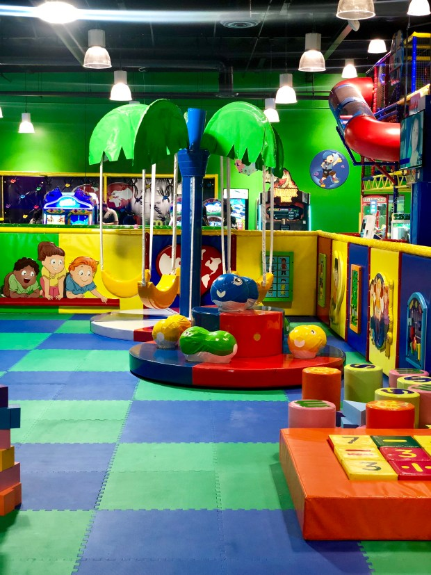 Colorful closed off play area with soft toys