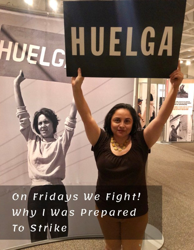 Woman standing with Huelga sign Strike