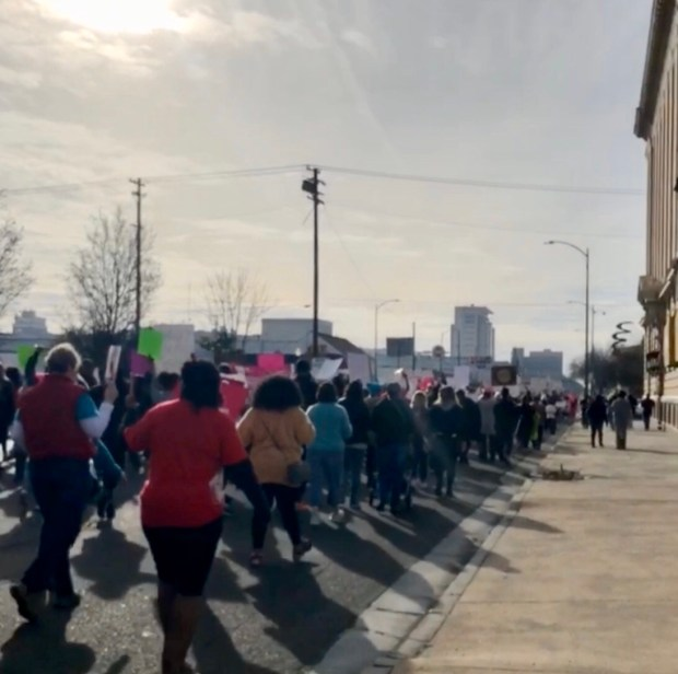 large crowd marching