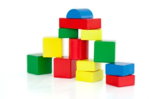 stockfresh_2491905_wooden-building-blocks-on-a-white-background_sizeXS