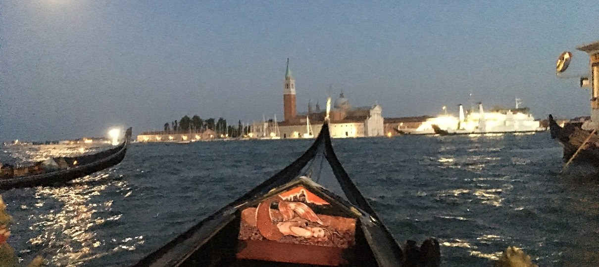 Ride on the canal with a gondola.