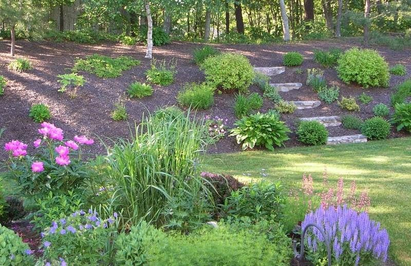 10 Stunning Landscape Ideas for a Sloped Yard | How To ... on Backyard Hill Landscaping Ideas  id=16084