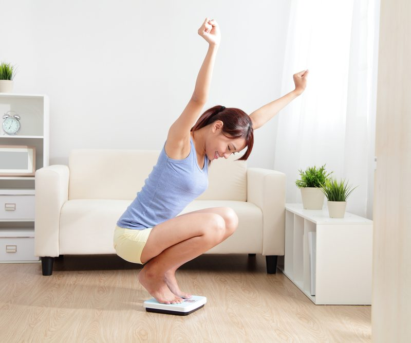 Working Out for Weight Loss: How to Lift With Extra Pounds