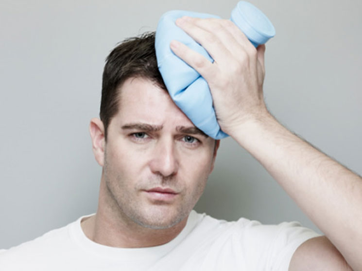 Ice compress curing inflammatory pain and headaches